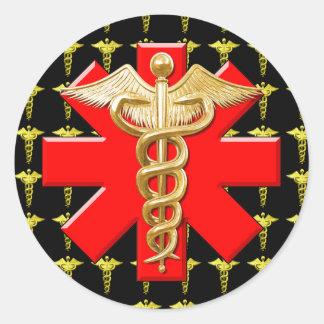 Caduceo del oro y cruz médica pegatina redonda