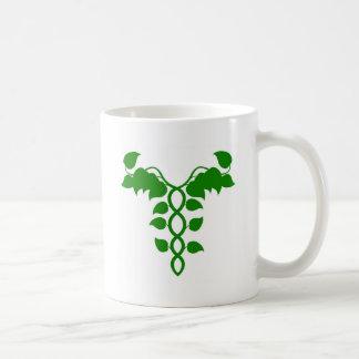 Caduceo holístico de la medicina o concepto de la  tazas de café