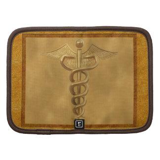 Caduceo médico del oro planificador
