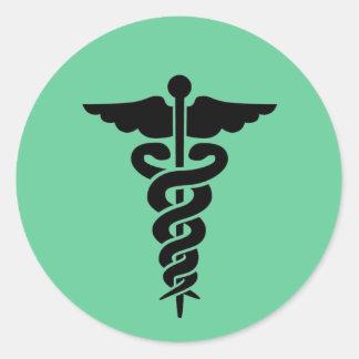 Caduceo médico del símbolo pegatina redonda