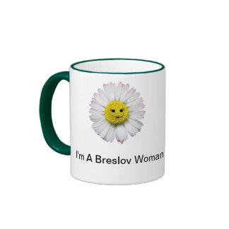 Café de la mujer de Breslov y taza del té en verde
