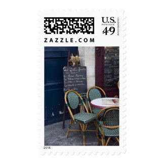 Cafe table with cane chairs in Paris, France Stamps