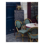 Cafe table with cane chairs in Paris, France Posters