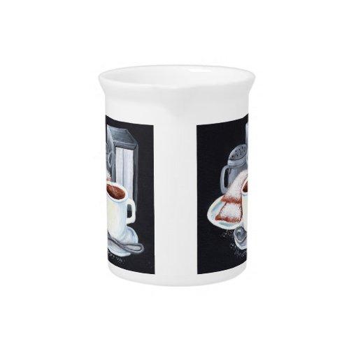 Café y jarra de Beignets