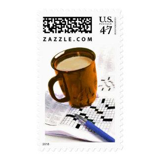 Café y un crucigrama sello