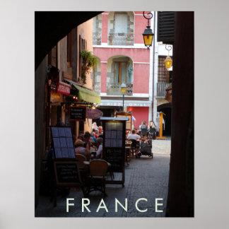 Cafés al aire libre, restaurantes en ciudad póster