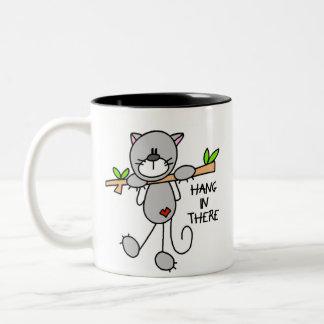 Caída en allí taza del gatito