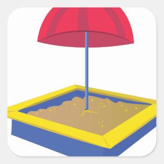 Caja de la arena pegatina cuadrada