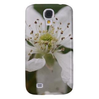 Caja de la galaxia S4 de Samsung con el flor blanc