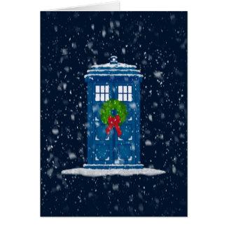 Caja de policía en nieve del navidad tarjeta