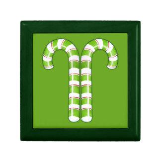 Caja de regalo verde de los bastones de caramelo