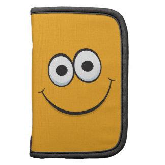 Caja en folio divertida de la cara sonriente feliz planificador
