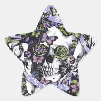 Caja púrpura y verde del cráneo de la mariposa del pegatina en forma de estrella