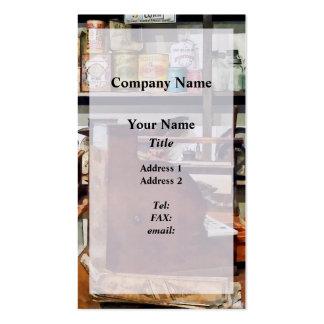 Caja registradora de madera en tienda general plantilla de tarjeta de negocio