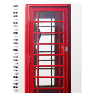 Caja roja británica famosa de la cabina de libretas espirales