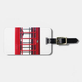 Caja roja británica famosa de la cabina de etiquetas maleta