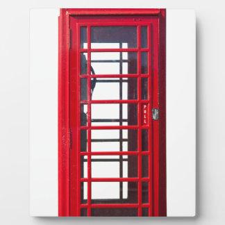 Caja roja británica famosa de la cabina de placas con fotos