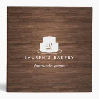 Cake Monogram Logo in White on Brown Woodgrain Binder