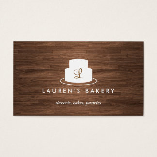 Cake Monogram Logo in White on Brown Woodgrain Business Card