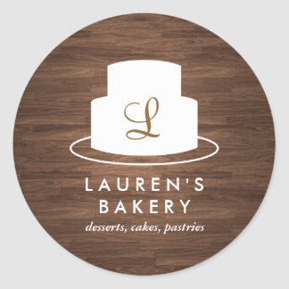 Cake Monogram Logo in White on Brown Woodgrain Classic Round Sticker
