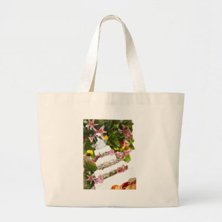 Cake with flowers in weddings large tote bag
