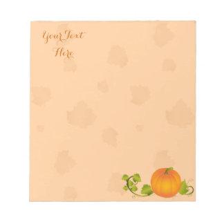 Calabaza de la vid del otoño con el texto bloc de notas
