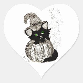 Calabaza de los ojos verdes del gato negro pegatina en forma de corazón