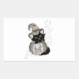 Calabaza de los ojos verdes del gato negro pegatina rectangular