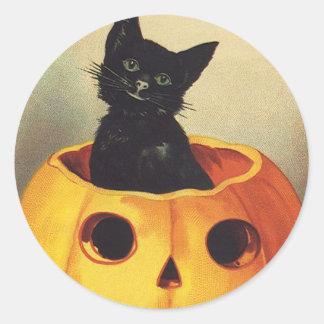 Calabaza linda sonriente del gato negro de etiqueta redonda