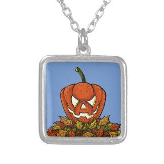 calabaza sonriente malvada de Halloween Colgante Cuadrado