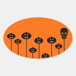 Calabaza y cráneo crecientes pegatina ovalada
