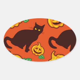 Calabazas de Halloween y gato negro Pegatina Ovalada