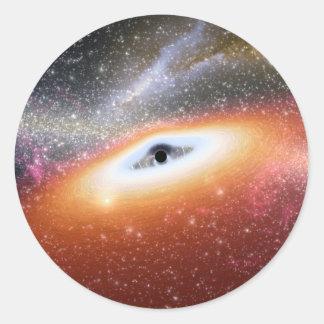 Calabozo en el centro de una galaxia pegatina redonda