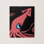 Calamar rosado gigante en fondo negro puzzle