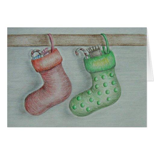 Calcetines del navidad con los caramelos felicitaciones