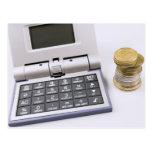 Calculadora y monedas postales