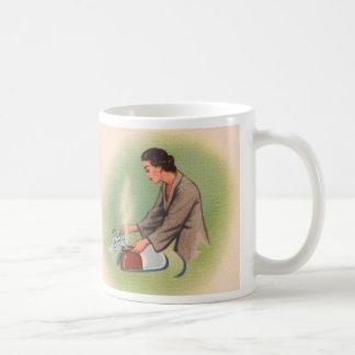 Caldera de té del ama de casa de los suburbios del taza de café