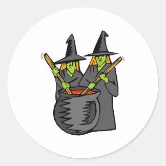 Caldera stiring witched dos etiqueta redonda