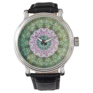 Caleidoscopio, lila y verde subacuáticos de la reloj de mano