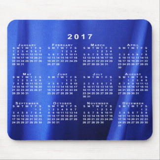 Calendario abstracto de seda azul cubierto de la alfombrilla de raton