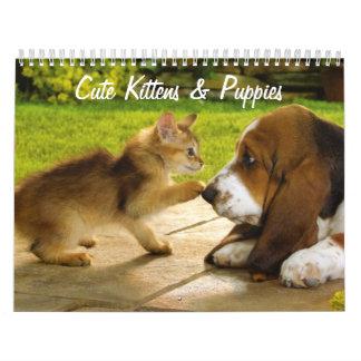 Calendario lindo de los perritos y de los gatitos