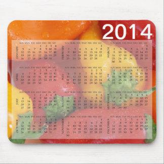 Calendario mojado colorido de los paprikas tapete de raton