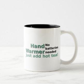 Calentador divertido de la mano de la cita de la t tazas de café