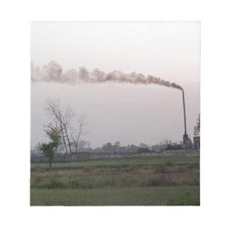 Calentamiento de la contaminación y del planeta blocs de papel