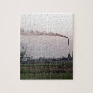 Calentamiento de la contaminación y del planeta puzzles
