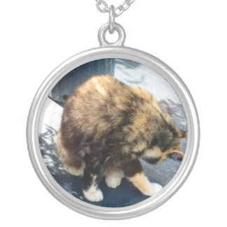 calico cat licking hind legs silver plated necklace