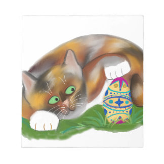 Calico Kitten Taps an Easter Egg with her Paw Notepad