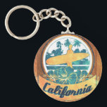 """California surfboard keychain<br><div class=""""desc"""">Hello,  this unique and funny design represents a surfboard with a retro and sweet blazon of California.</div>"""