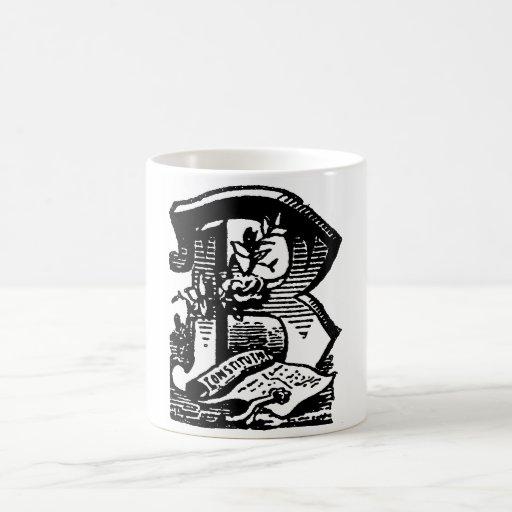 Caligrafía antigua que pone letras a la letra masó tazas de café