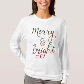 Caligrafía feliz y brillante del navidad playera
